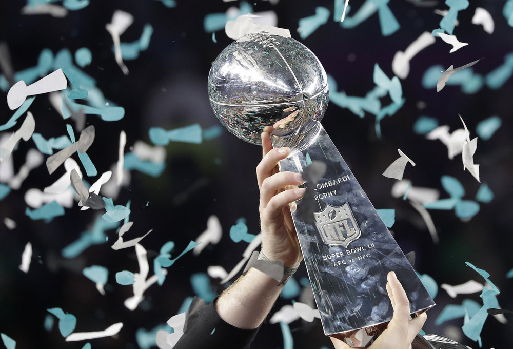 Philadelphia Eagles' Carson Wentz holds up the Vince Lombardi Trophy after the NFL Super Bowl 52 football game against the New England Patriots, Sunday, Feb. 4, 2018, in Minneapolis. The Eagles won 41-33. (AP Photo/Matt Slocum)