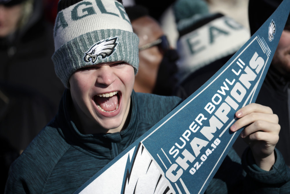 A Philadelphia Eagles fan chants while waiting for the team to arrive at Philadelphia International Airport a day after defeating the New England Patriots in Super Bowl 52 in Minneapolis, Monday, Feb. 5, 2018. (AP Photo/Julio Cortez)