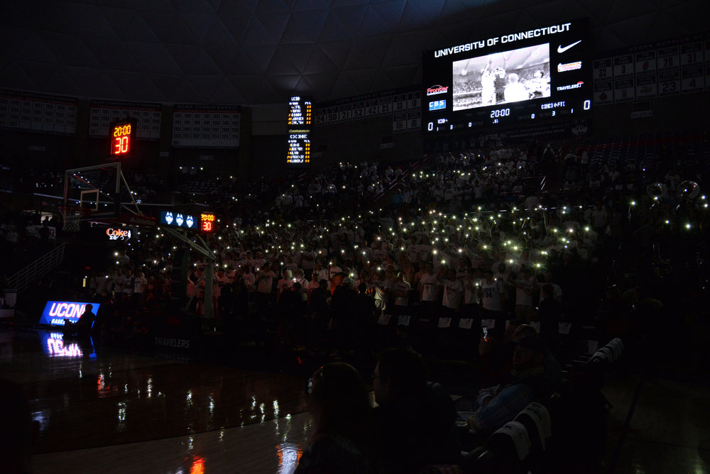 The student section (illuminated by cell phones) was packed for the Huskies loss to Cincinnati on Saturday but apparently Twitter trolls didn't notice. (Amar Batra/The Daily Campus)