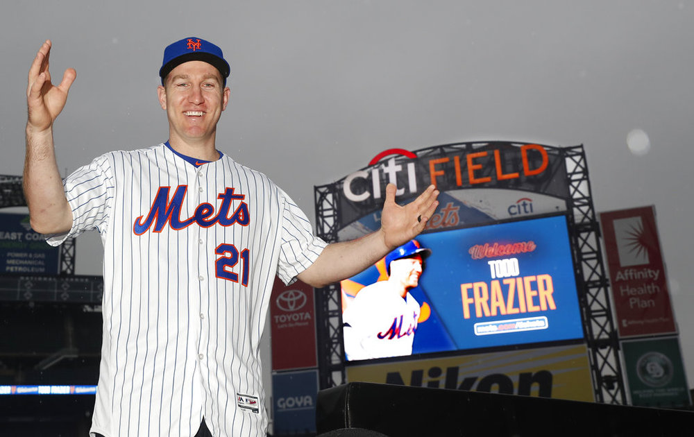 New York Mets newly-signed third baseman Todd Frazier gestures as he stands  in the 4fd9fc72425