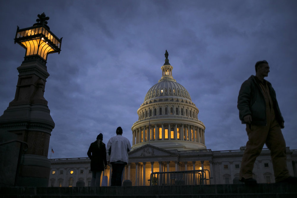 In this Jan. 21, 2018, file photo, lights illuminate the U.S. Capitol on second day of the federal shutdown as lawmakers negotiate behind closed doors in Washington. (AP Photo/J. Scott Applewhite, File)
