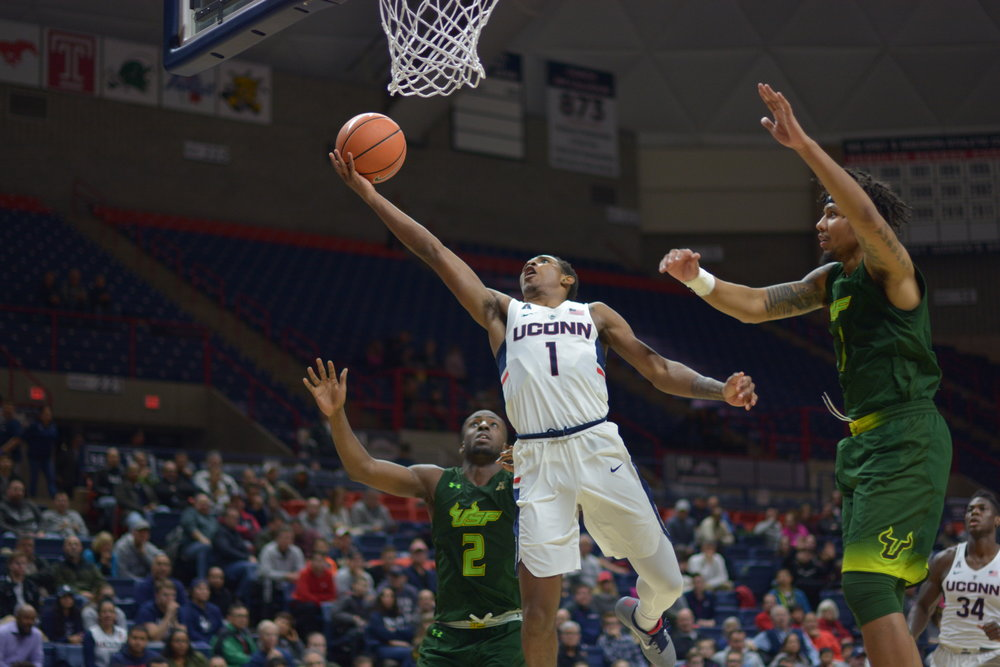 Christian Vital (#1) rises up for a layup in Wednesday's game against USF. (Amar Batra/The Daily Campus)