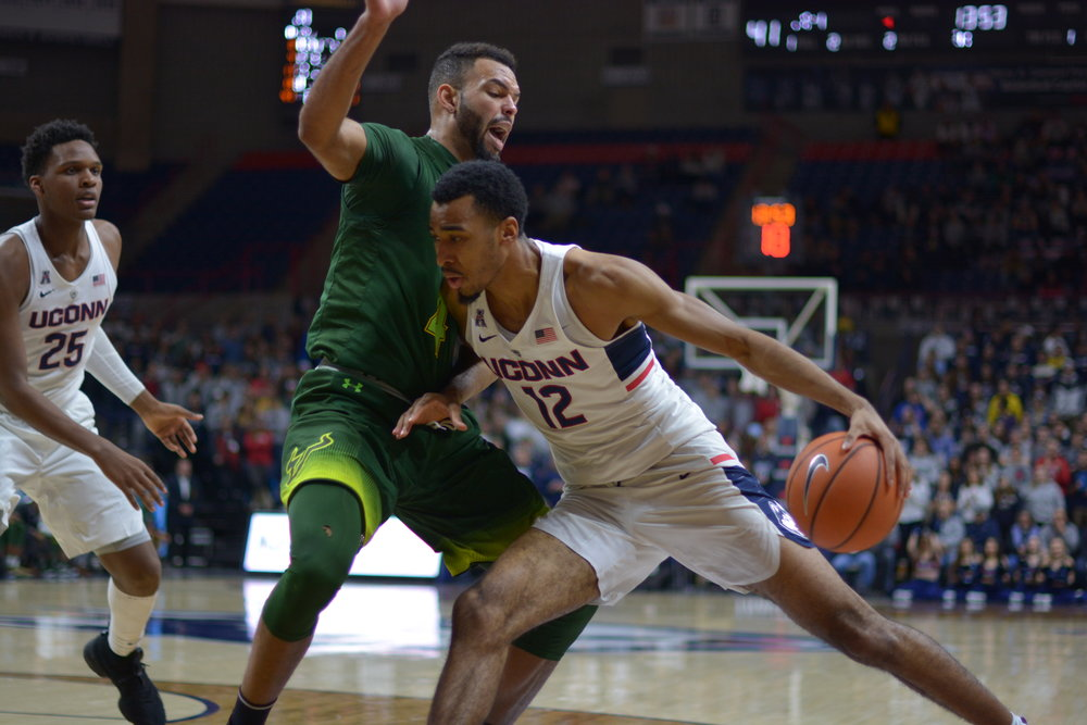 UConn Men's Basketball defeats USF 68-65 in Gampel Pavilion Wednesday night. Stephen Jiggets led the team with 18 points in the first half and Jalen Adams led with 19 points in the second half. (Nick Hampton/The Daily Campus)