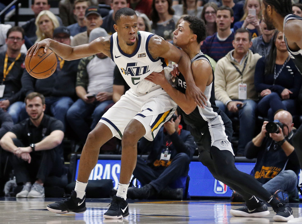 FILE - In this Dec. 21, 2017, file photo, San Antonio Spurs guard Bryn Forbes, right, guards Utah Jazz guard Rodney Hood during the first half of an NBA basketball game, in Salt Lake City. The Cavaliers sent guard Derrick Rose and forward Jae Crowder to the Utah Jazz for forward Rodney Hood, Thursday, Feb. 8, 2018. (AP Photo/Rick Bowmer, File)