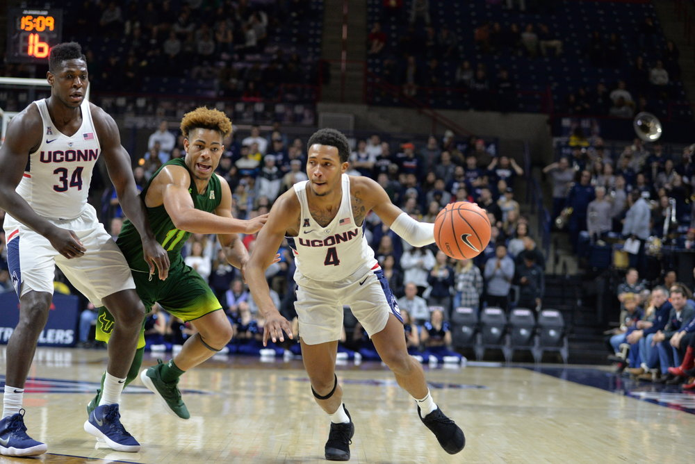 Jalen Adams maneuvers against USF at Gampel Pavilion (Amar Batra/The Daily Campus)