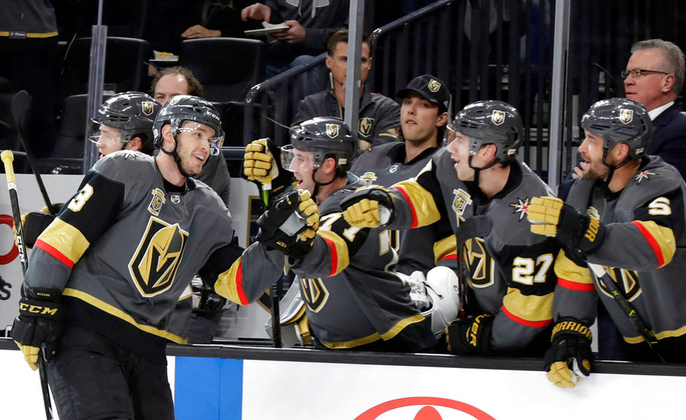 Vegas Golden Knights Brayden McNabb celebrates with teammates after a goal against the Philadelphia Flyers during the first period of an NHL hockey game Sunday, Feb. 11, 2018, in Las Vegas. (AP Photo/Isaac Brekken)