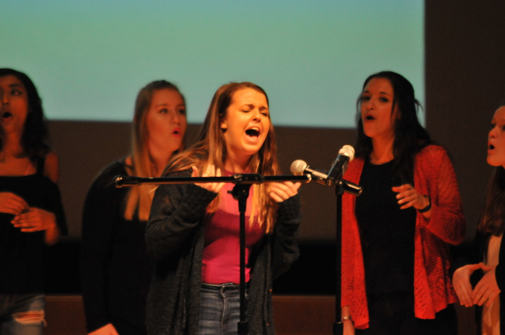 Various Acapella groups perform in the Student Union Theatre on Saturday, Feb 10. The groups sing a variety of popular songs, ranging from Michael Jackson to Bruno Mars. (Jon Sammis/The Daily Campus)