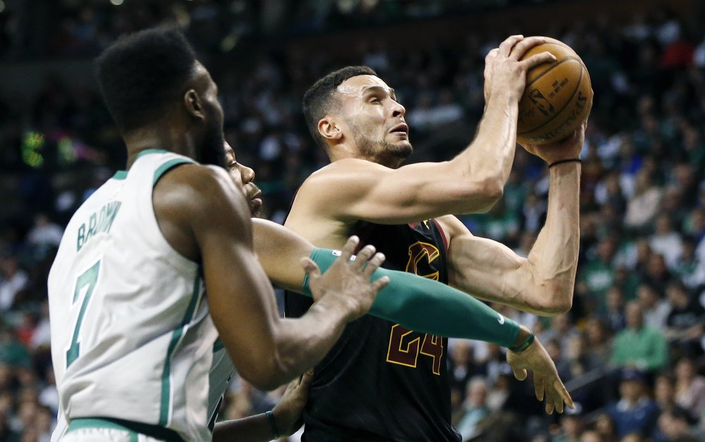 Cleveland Cavaliers' Larry Nance Jr. (24) drives for the basket against Boston Celtics' Greg Monroe, behind left, and Jaylen Brown (7) during the fourth quarter of an NBA basketball game in Boston, Sunday, Feb. 11, 2018. (AP Photo/Michael Dwyer)