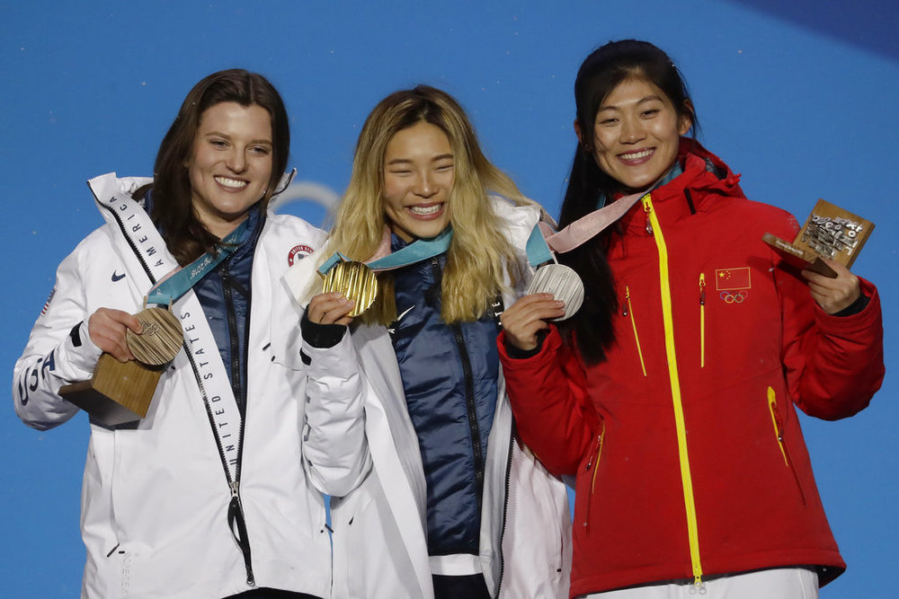Women's halfpipe medalists from right, China's Liu Jiayu silver, United States' Chloe Kim, gold, and United States' Arielle Gold, bronze, pose during their medals ceremony at the 2018 Winter Olympics in Pyeongchang, South Korea, Tuesday, Feb. 13, 2018. (Morry Gash/AP)
