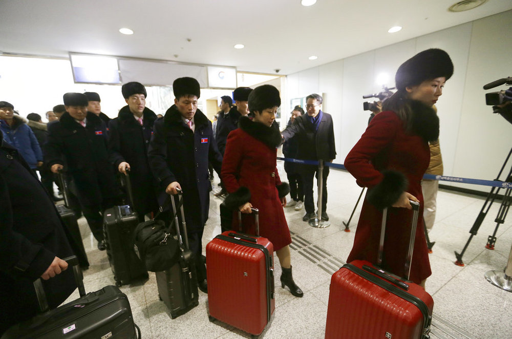 Members of North Korea's Taekwondo demonstration team arrive at the Inter-Korean Transit Office near the Demilitarized zone in Paju, South Korea, to return to North Korea Thursday, Feb. 15, 2018. (AP Photo/Ahn Young-joon)