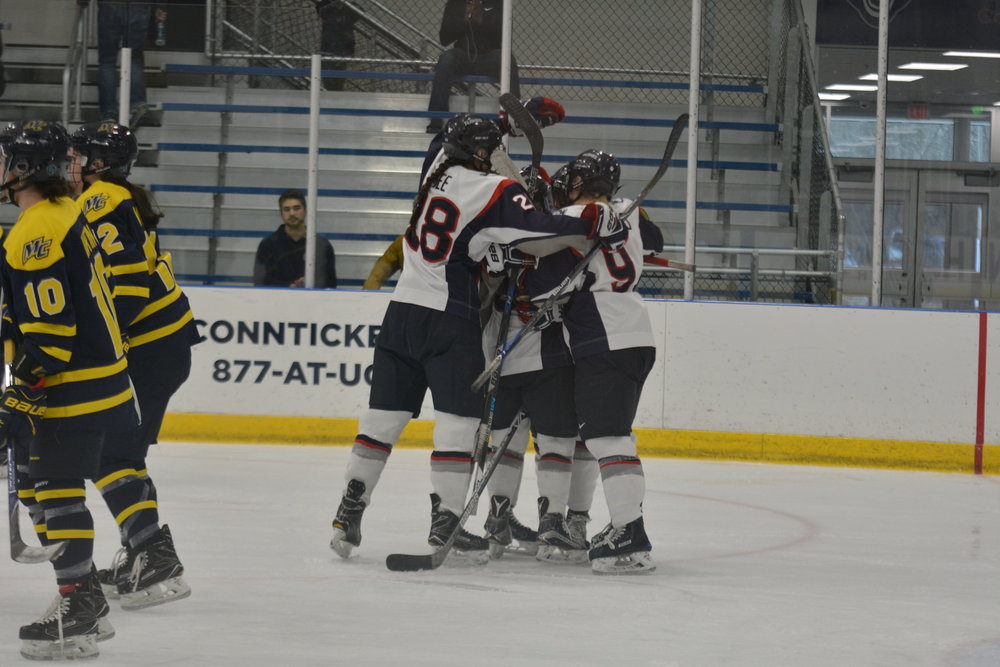 The Huskies celebrate a goal in their home finale against Merrimack over the weekend (Jon Sammis/The Daily Campus)