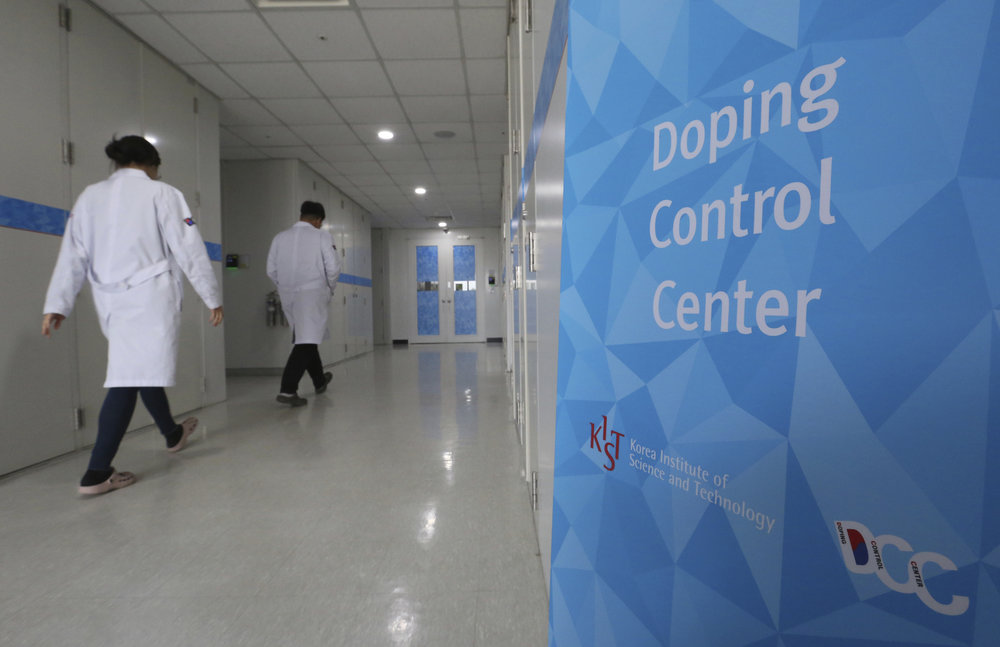 Researches enter into the Doping Control Center at the Korea Institute of Science and Technology in Seoul, South Korea, Monday, Feb. 19, 2018. Russia could lose its chance to be reinstated before the end of the Winter Olympics because of a doping charge against curling bronze medalist Alexander Krushelnitsky. (AP Photo/Ahn Young-joon)