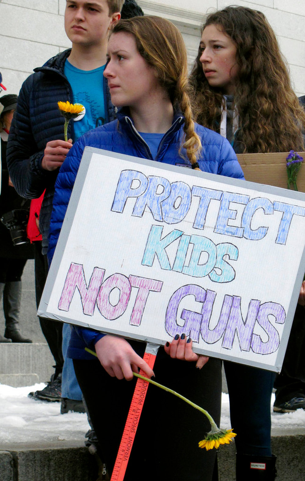 Alex Devaux, of Richmond, Vt., holds a sign outside the Vermont Statehouse in Montpelier, Vt., on Tuesday Feb. 20, 2018. Devaux, a high school senior, attended the demonstration that followed comments by Republican Gov. Phil Scott who said he was open to discussion about gun control as part of a broader discussion of ways to reduce violence. Scott's comments came after Vermont police arrested a suspect who they say was preparing for a school shooting. Vermont has long been considered to have some of the most lax gun control laws in the country. (AP Photo/Wilson Ring)