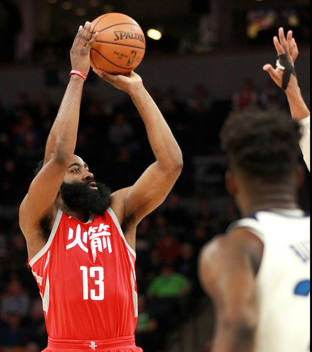 Houston Rockets guard James Harden (13) shoots against the Minnesota Timberwolves during the third quarter of an NBA basketball game Tuesday, Feb. 13, 2018, in Minneapolis. The Rockets defeated the Timberwolves 126-108. (AP Photo/Andy Clayton-King)