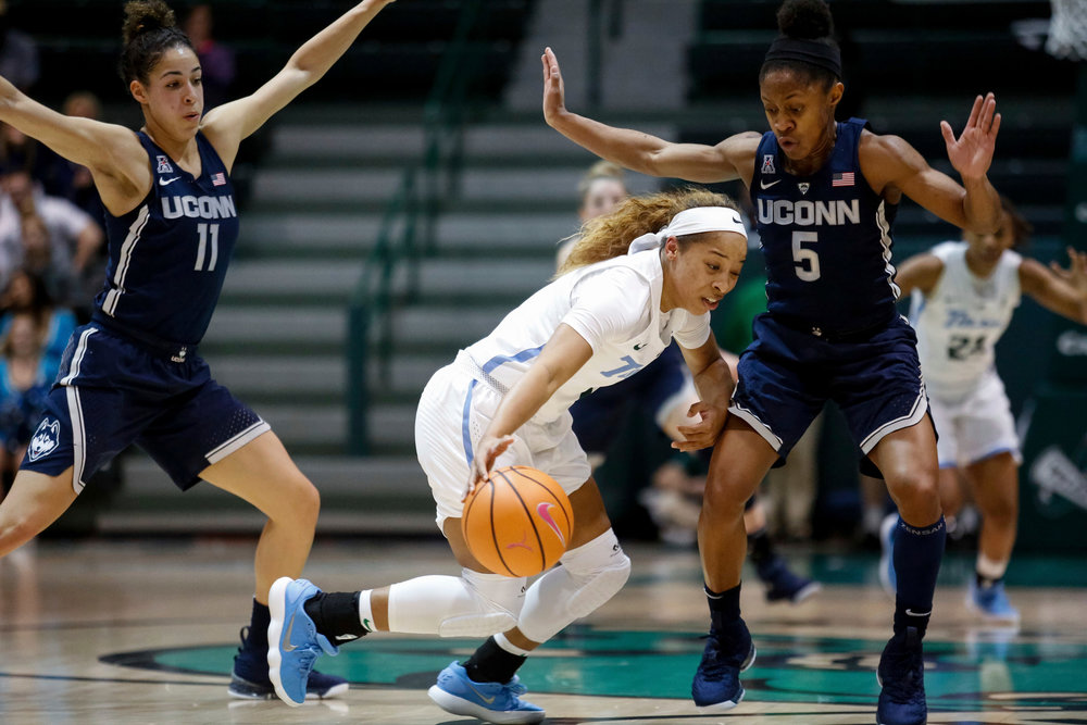 Connecticut guard Kia Nurse (11) and Connecticut guard Crystal Dangerfield (5) try to trap Tulane guard Kaila Anderson (1) during the first half of an NCAA college basketball game in New Orleans, Wednesday, Feb. 21, 2018. (AP Photo/Scott Threlkeld)