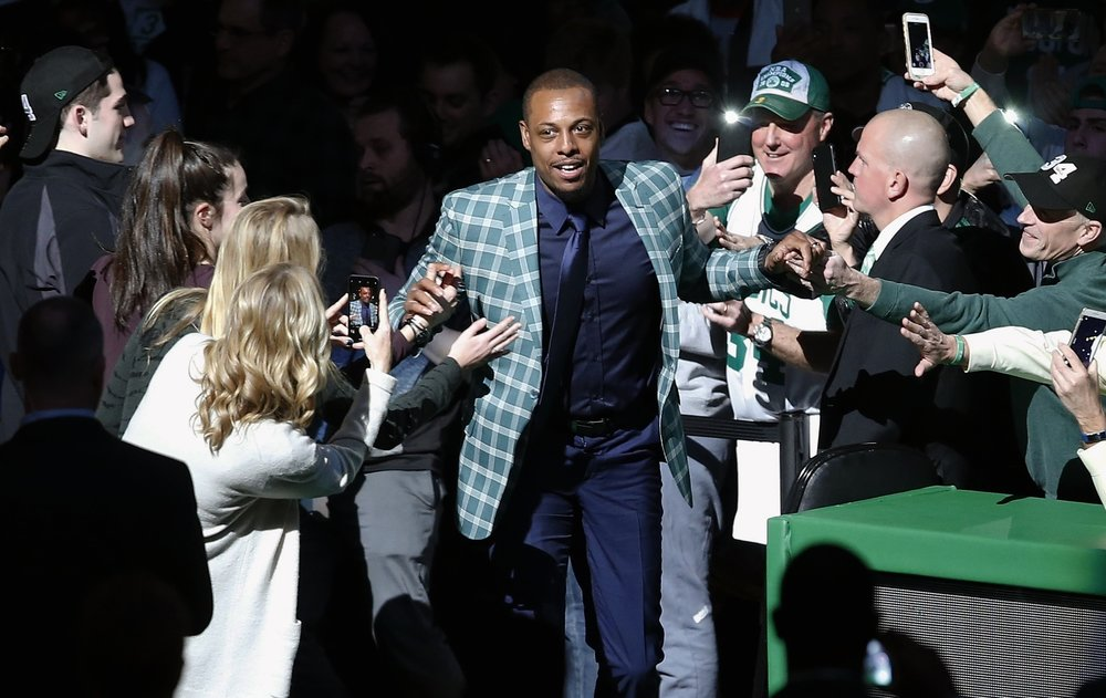 Former Boston Celtics Paul Pierce comes onto the court during a ceremony to retire his number following an NBA basketball game against the Cleveland Cavaliers in Boston, Sunday, Feb. 11, 2018. (AP Photo/Michael Dwyer)