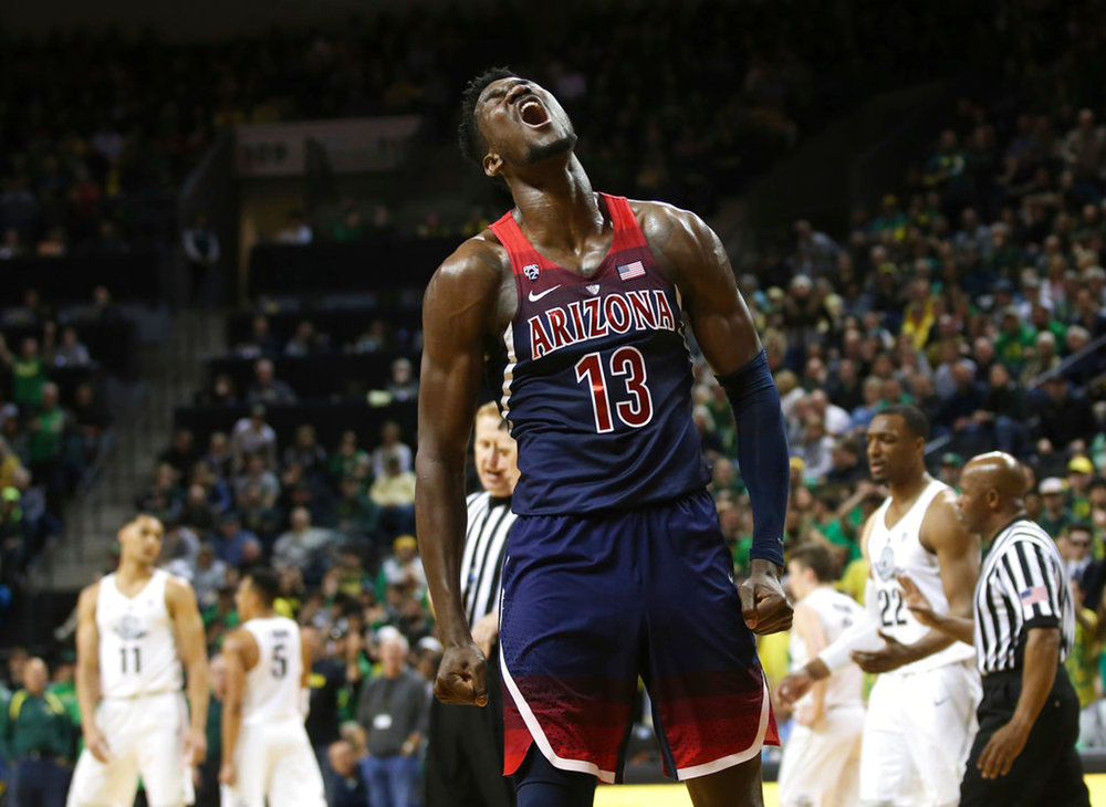 Arizona's DeAndre Ayton celebrates during the second half against Oregon in an NCAA college basketball game Saturday, Feb. 24, 2018, in Eugene, Ore. Oregon won 98-93 in overtime. (AP Photo/Chris Pietsch)