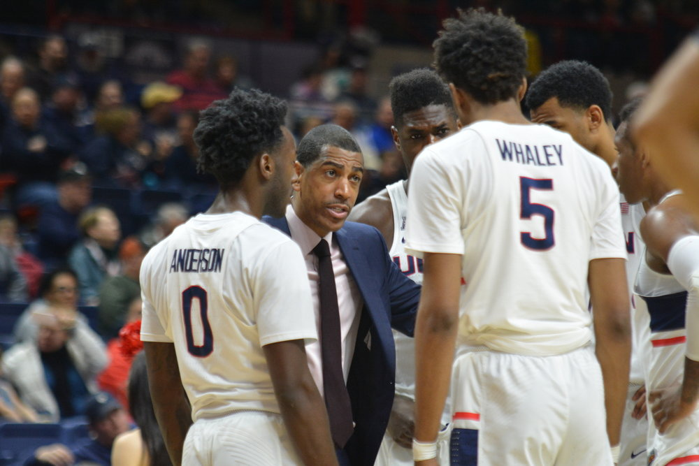 Head Coach Kevin Ollie instructs his Huskies against Memphis on Sunday (Olivia Stenger/The Daily Campus)