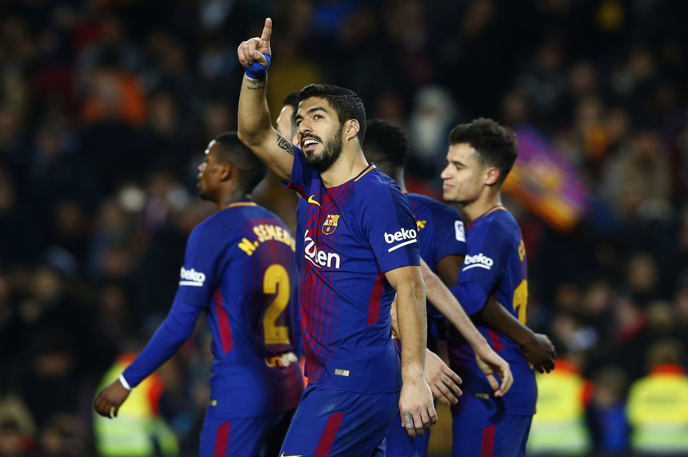 FC Barcelona's Luis Suarez celebrates after scoring during the Spanish La Liga soccer match between FC Barcelona and Girona at the Camp Nou stadium in Barcelona, Spain, Saturday, Feb. 24, 2018. (AP Photo/Manu Fernandez)