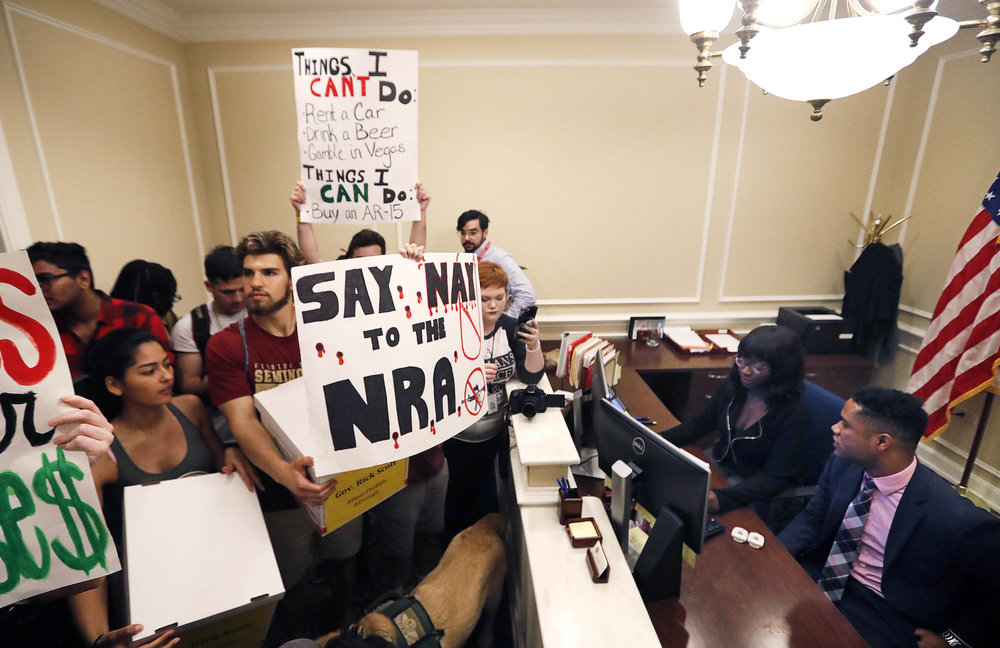 Students stand at the entrance to the office of Florida Gov. Rick Scott with boxes of petitions for gun control reform, at the state Capitol in Tallahassee, Fla on Feb. 21, 2018. Over a dozen students and teachers were killed on Valentine's Day in a mass shooting at Marjory Stoneman Douglas High School in Parkland, Fla. (Gerald Herbert/AP)