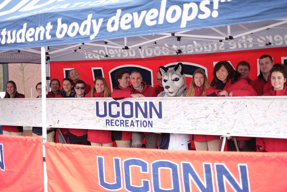 Jonathan the mascot poses with UConn's Rec Center behind an I-Beam signed by UConn students. The beam will be added to the rest of the Rec Center's frame on Tuesday, Feb. 27, 2018. (Jon Sammis/The Daily Campus)