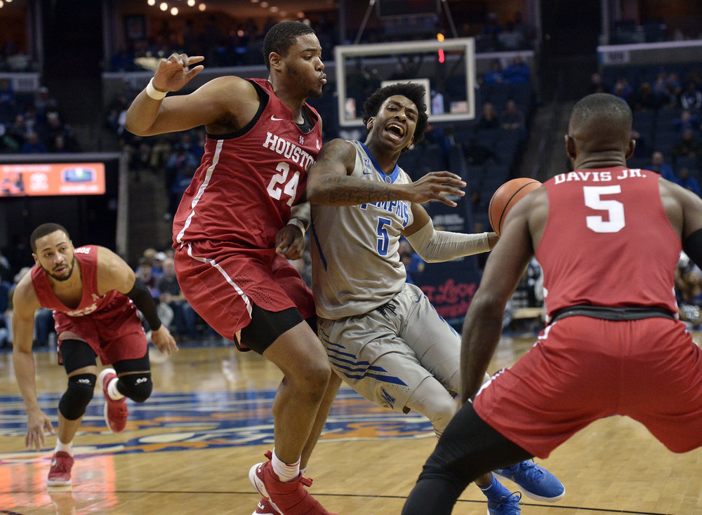 Memphis guard Kareem Brewton Jr. (5) drives against Houston forward Breaon Brady (24) as Houston guards Galen Robinson Jr., left, and Corey Davis Jr. (5) look on in the second half of an NCAA college basketball game Thursday, Feb. 22, 2018, in Memphis, Tenn. (AP Photo/Brandon Dill)