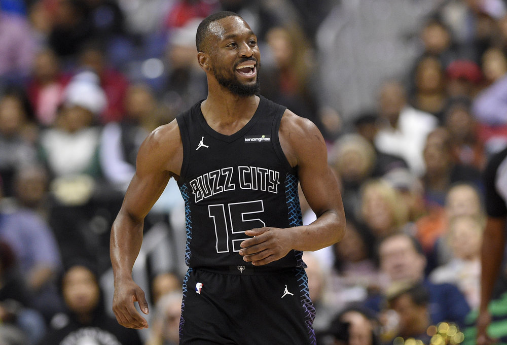 Charlotte Hornets guard Kemba Walker (15) reacts during the second half of an NBA basketball game against the Washington Wizards, Friday, Feb. 23, 2018, in Washington. (AP Photo/Nick Wass)