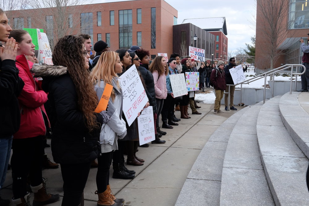 "Students and faculty gather to the steps of the Student Union to protest the recent Executive Order issued by President Donald Trump. Various speakers and activists pass the megaphone and speak out against the ""Muslim Ban"" issued last week. A small group of Republicans went to protest their side of the argument, holding an American flag. (John Sammis/The Daily Campus)"