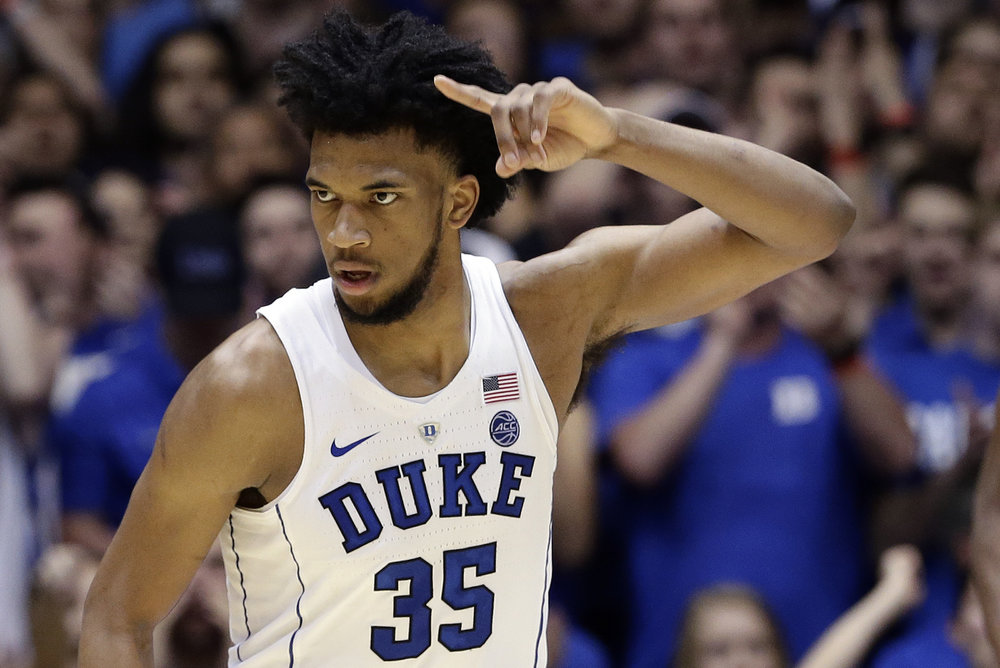 Duke's Marvin Bagley III (35) reacts following a basket against Syracuse during the second half of an NCAA college basketball game in Durham, N.C., Saturday, Feb. 24, 2018. (AP Photo/Gerry Broome)
