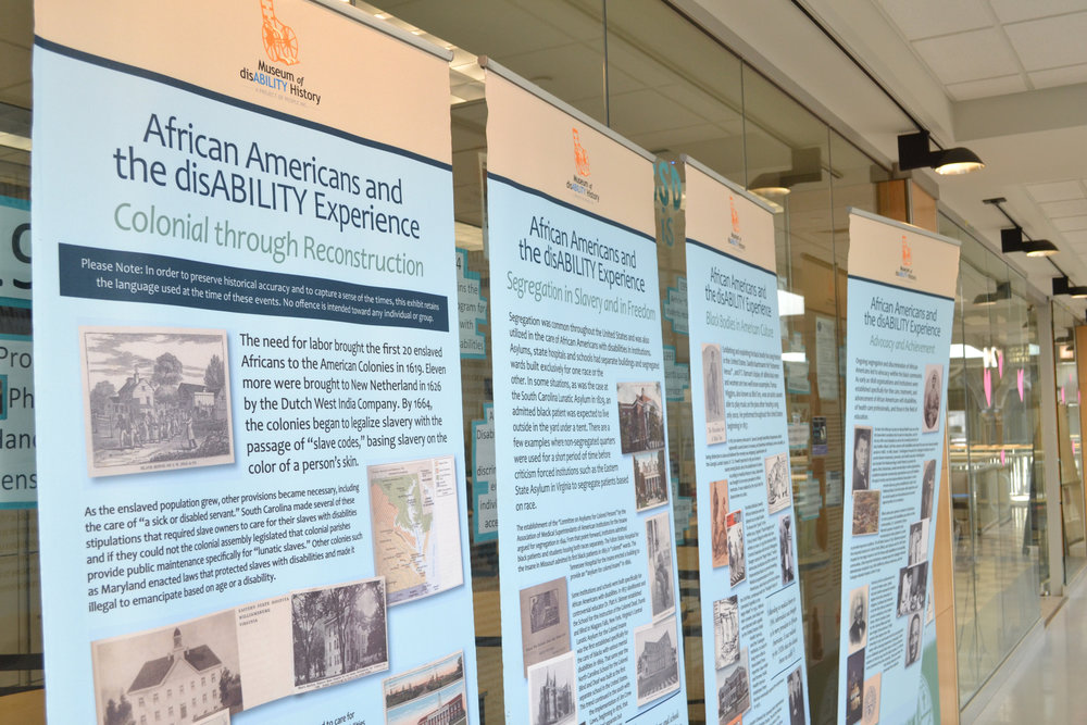 A five-panel banner stands outside of the Center for Students with Disabilities in Wilbur Cross highlighting African Americans who experienced disabilities. The exhibit will run through March 2. (Olivia Stenger/The Daily Campus)