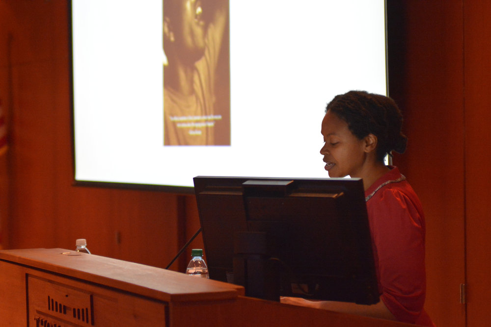 Shatema Threadcraft presents her talk titled Spectacular Death: Lynching, Lethal Police Violence, and the Black Female Body in Konover auditorium Wednesday evening. Threadcraft is an assistant professor of Political Science at Rutgers University. (Nicholas Hampton/The Daily Campus)