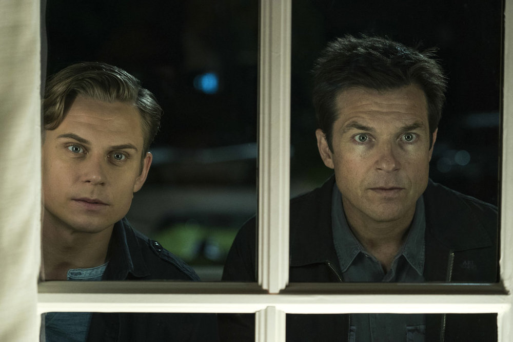 "This image released by Warner Bros. Entertainment shows Billy Magnussen, left, and Jason Bateman in a scene from ""Game Night."" (Hopper Stone/Warner Bros. Entertainment via AP)"