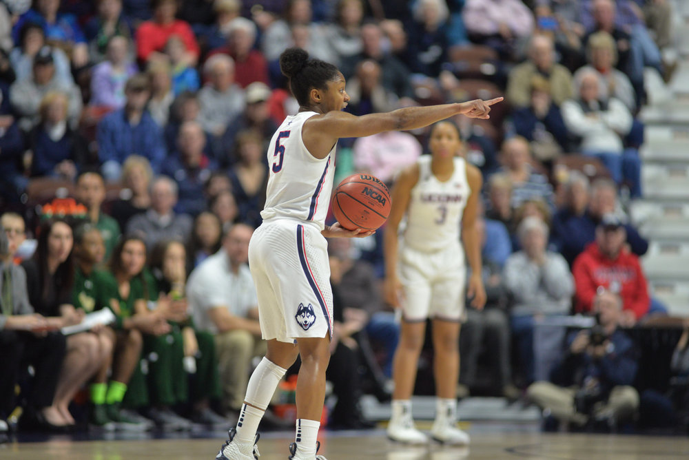 Sophomore guard Crystal Dangerfield directs a play during the Huskies 70-54 victory over USF at Mohegan Sun Area on March 6, 2018. (Amar Batra/The Daily Campus)