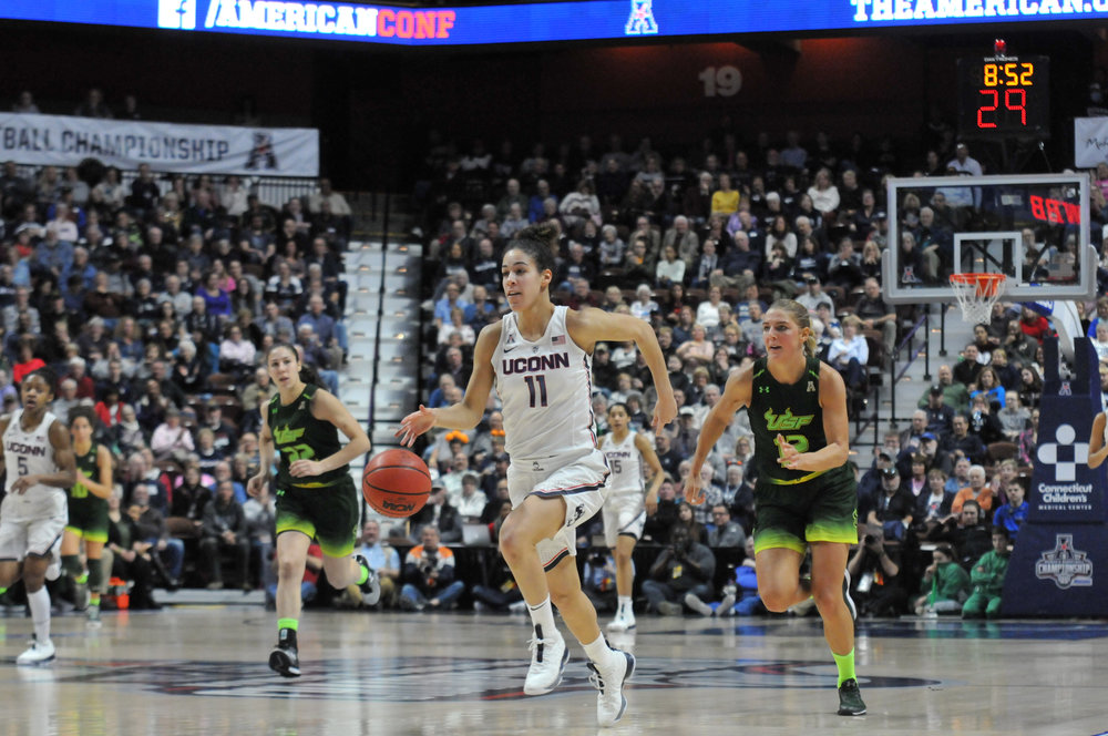 Senior guard Kia Nurse drives down the court during the Huskies 70-54 victory over USF in the final game of the AAC Championship on Tuesday, March 6, 2018. (Amar Batra/The Daily Campus)