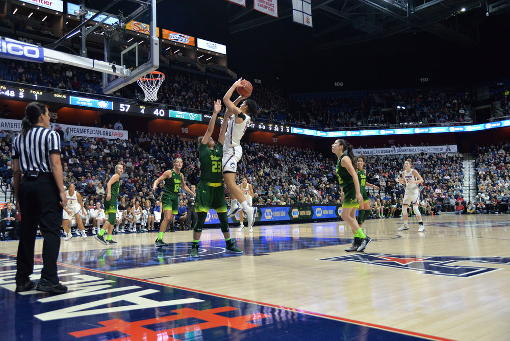 Gabby Williams prepares to fire off a shot during the Huskies 70-54 victory over the USF Bulls in the championship game of the American Athletic Conference Championship. Williams led the team with 19 total points. (Amar Batra/The Daily Campus)