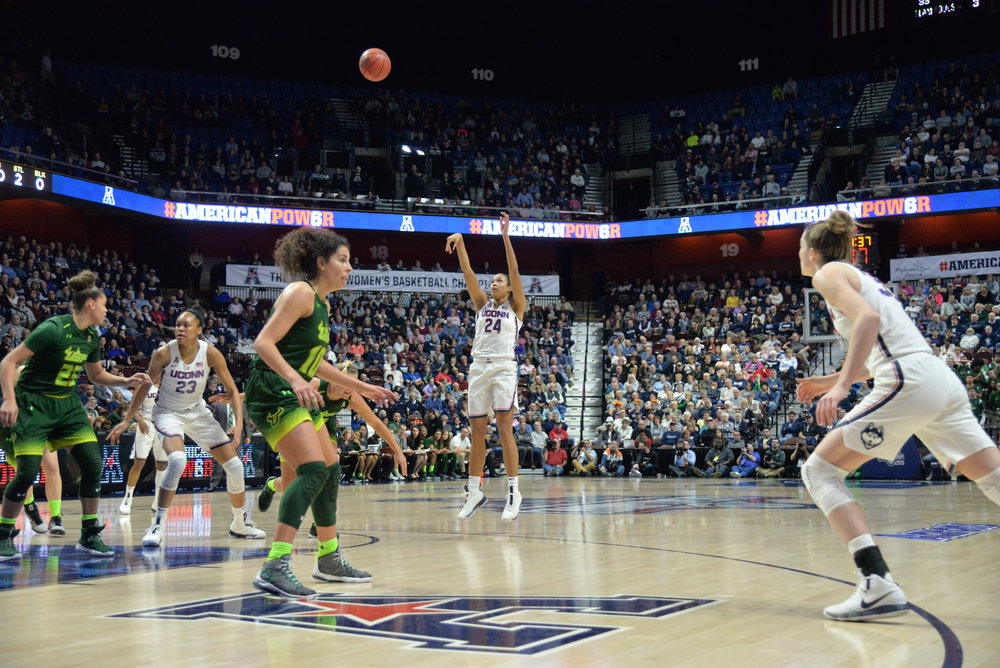 Napheesa Collier (24) floats a shot over the USF defense during the Huskies 70-54 victory over the Bulls in the championship game of the American Athletic Conference Championship at Mohegan Sun Arena on Tuesday, March 6, 2018. (Amar Batra/The Daily Campus)