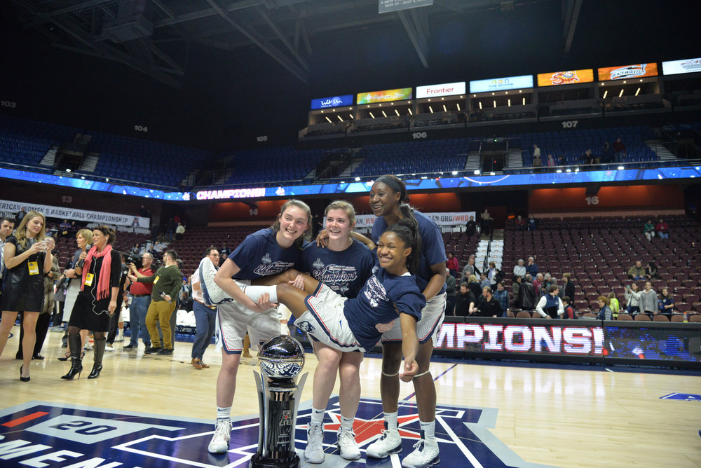 Sophomore guard Crystal Dangerfield celebrates with her teammates after the Huskies defeated the USF Bulls to win the AAC Championship tournament at Mohegan Sun Arena. (Amar Batra/The Daily Campus)