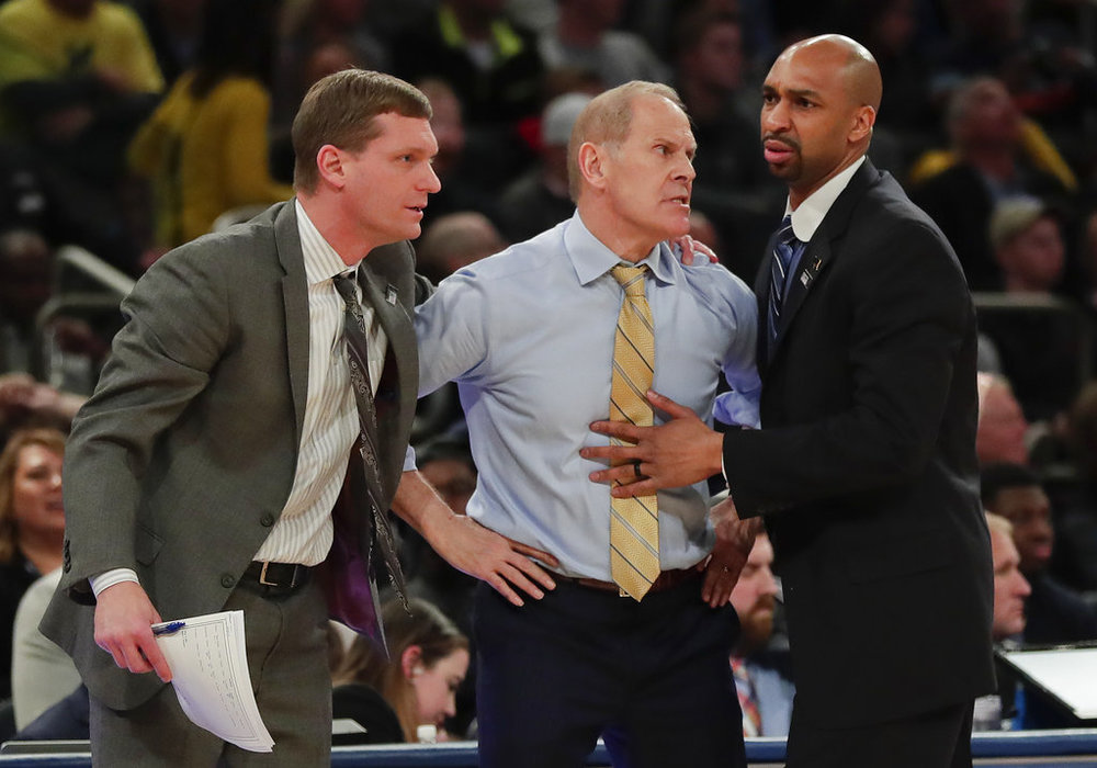 Michigan head coach John Beilein, center, reacts to a call during the second half of the NCAA Big Ten Conference tournament championship college basketball game against Purdue, Sunday, March 4, 2018, in New York. Michigan won 75-66. (AP Photo/Julie Jacobson)