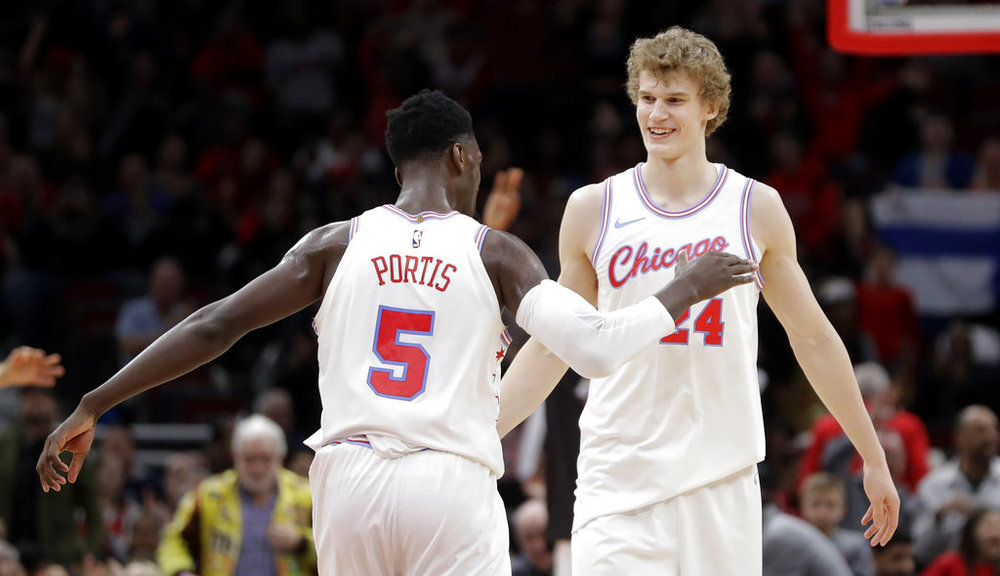 Chicago Bulls' Bobby Portis (5) and Lauri Markkanen celebrates Markkanen's clutch score late in the second half of an NBA basketball game against the Dallas Mavericks, Friday, March 2, 2018, in Chicago. (AP Photo/Charles Rex Arbogast)