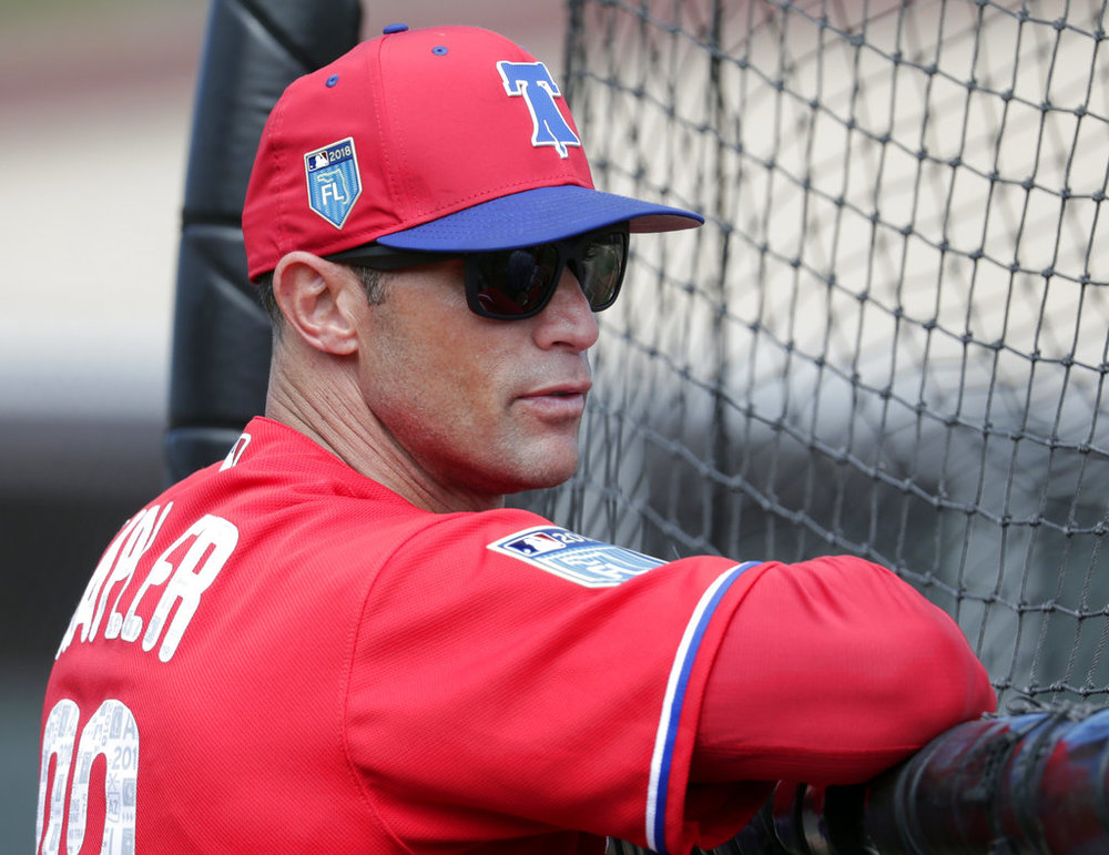FILE - In this Feb. 20, 2018, file photo, Philadelphia Phillies manager Gabe Kapler watches batting practice at baseball spring training camp in Clearwater, Fla. Kapler has brought a new-school philosophy, a ton of energy and plenty of positivity to an organization that needed revitalization after five straight losing seasons. (AP Photo/Lynne Sladky, File)