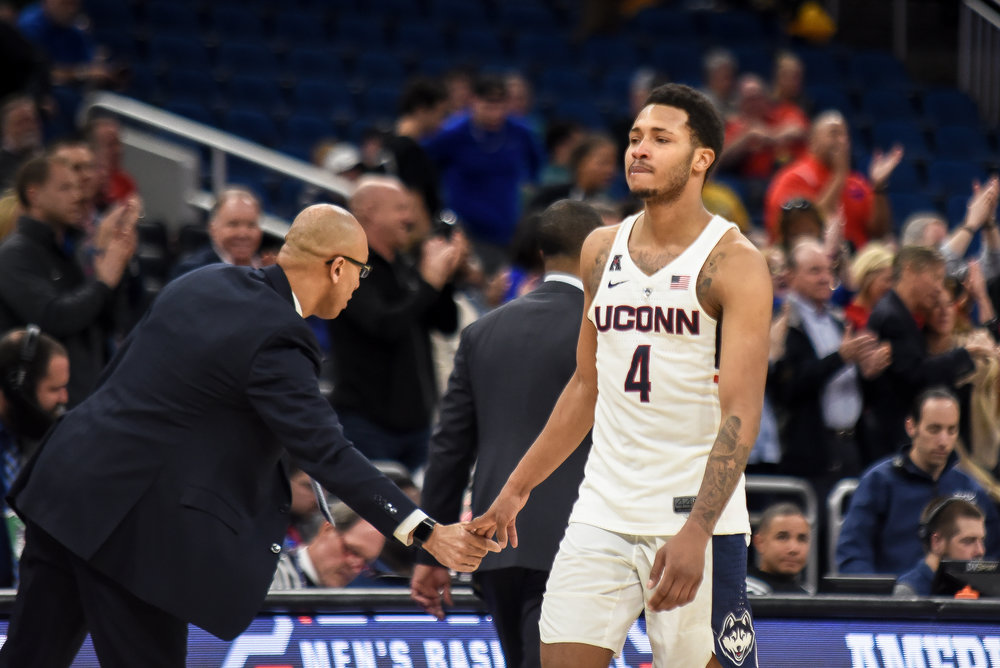 Jalen Adams heads to the bench in UConn's 80-73 loss to SMU in the first round of the American Athletic Conference tournament on Thursday, March 8 at the Amway Center in Orlando. Adams finished with just six points in 40 minutes. (Charlotte Lao/The Daily Campus)