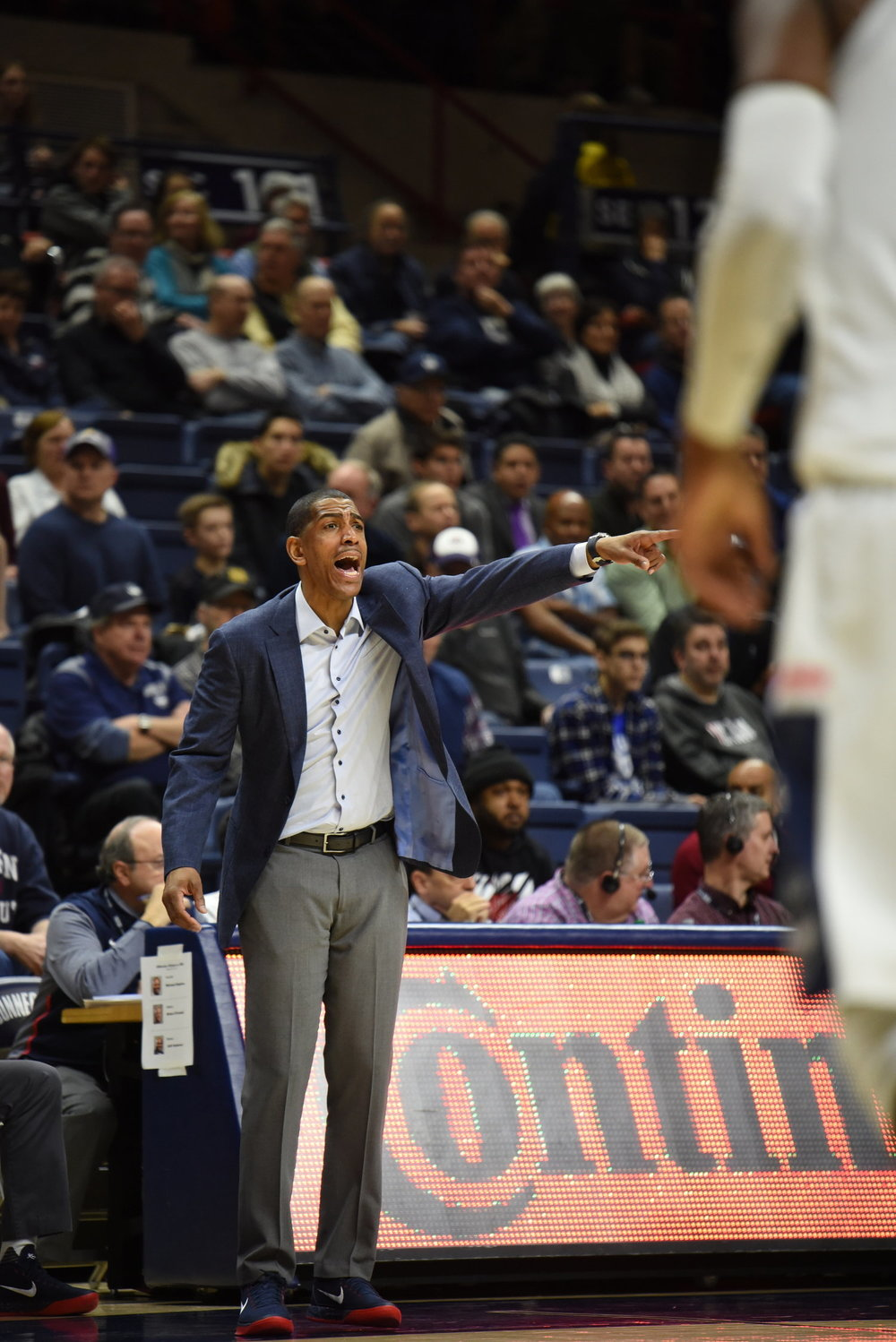 Kevin Ollie on the sidelines against Houston this season. (Charlotte Lao/The Daily Campus)