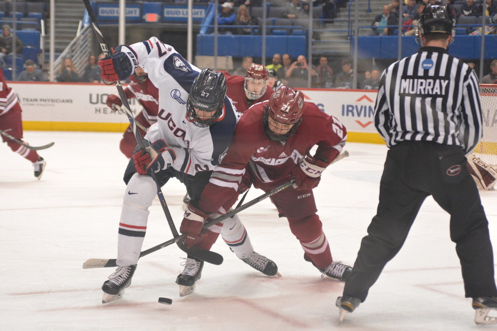 UConn forward Maxim Letunov faces off with a UMass center for control of the puck in the Huskies' 3-2 loss to the Minutemen on Feb. 22. (Nick Hampton/The Daily Campus)