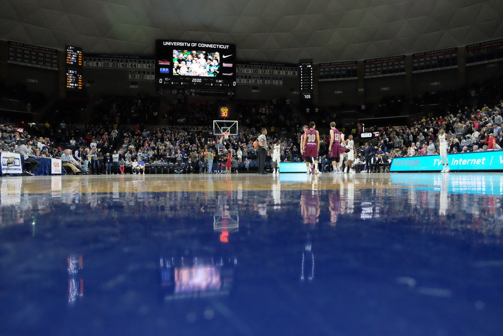 With a full crowd and cheers at their backs, the Mens Basketball team gets ready to put out 110% effort.