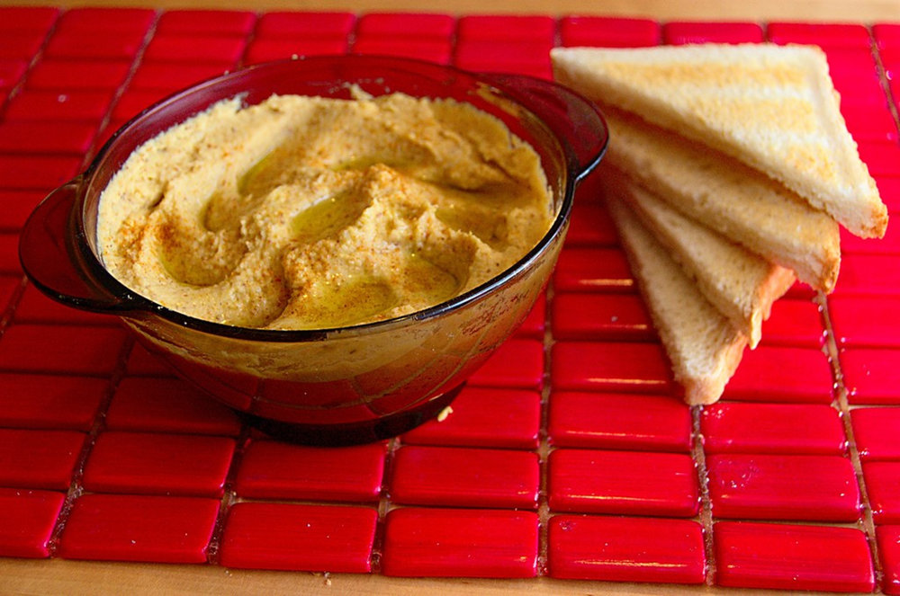 Hummus is a really good source of protein and can be eaten with rice cakes, vegetables or even NutThins, sunflower seed crackers or any other type of gluten-free cracker you can find in the gluten-free aisle. ( Albertas Agejevas /Creative Commons Flickr)