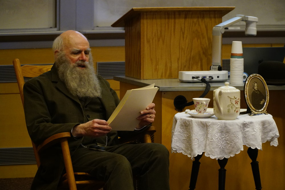 Professor Kenneth Noll from UConn's Molecular and Cell Biology Department portrays Mr. Charles Darwin through his religious faith and its influence in his studies in science. (Eric Wang/The Daily Campus)