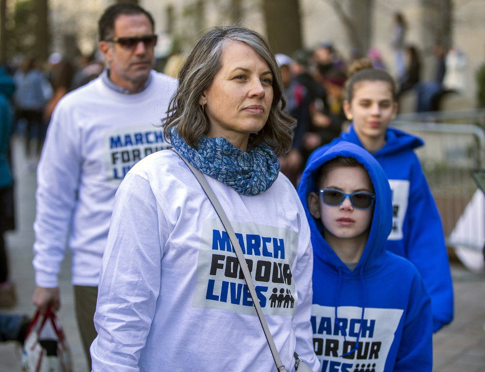 Sam and Wendy Ladah, of Pound Ridge, N.Y., and their children Micah and Helena attend the March For Our Lives rally in Washington, D.C., Saturday, March 24, 2018. (Mark Pynes/PennLive.com via AP)