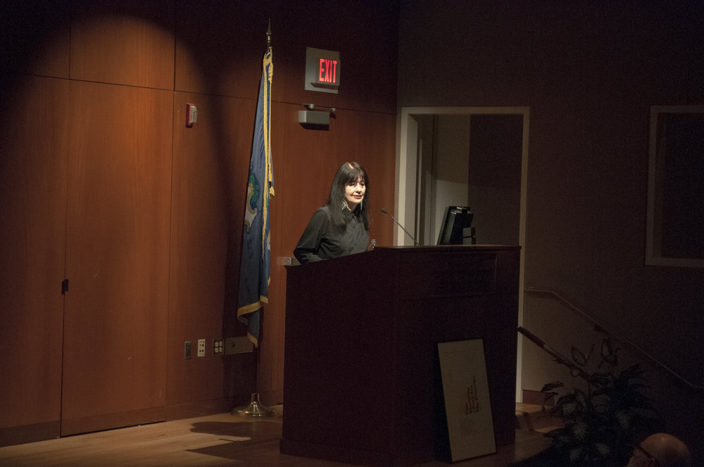 Renowned poet Joy Harjo shares poems, stories, and songs at Konover Auditorium of the Dodd Center on March 28th, 2018. (Judah Shingleton/The Daily Campus)