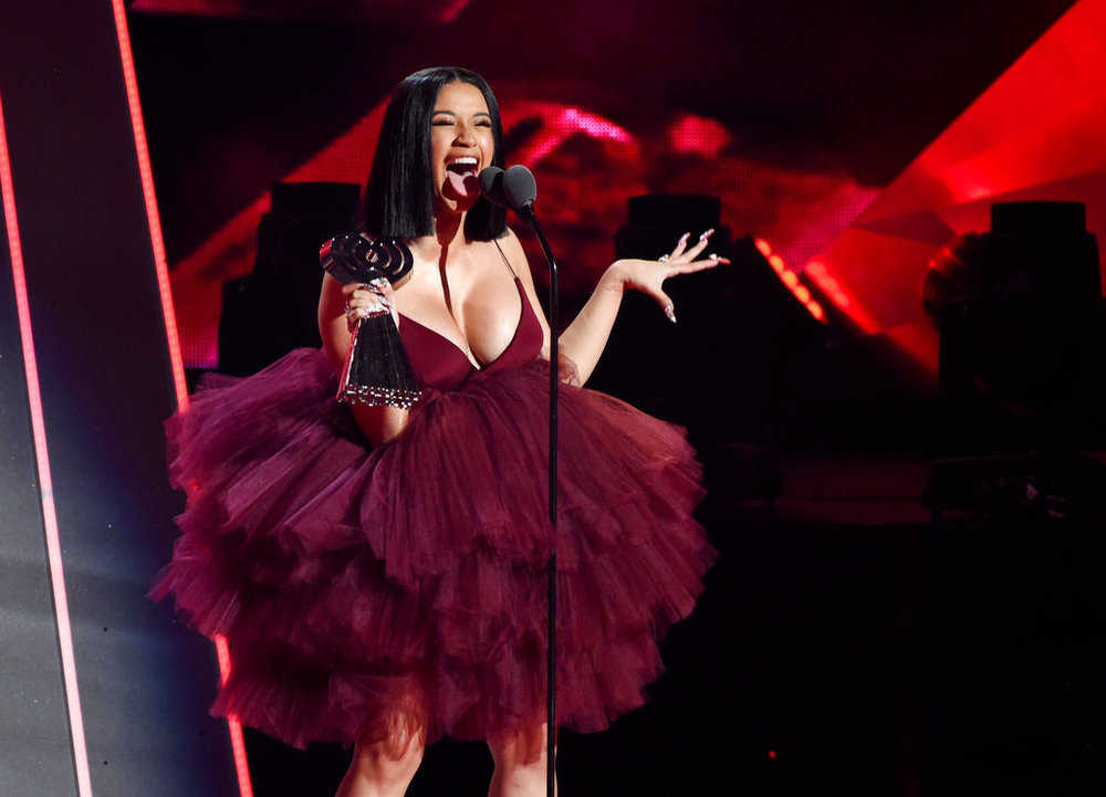 "In this March 11, 2018, file photo, Singer Cardi B accepts the Best New Artist award during the 2018 iHeartRadio Music Awards at The Forum in Inglewood, Calif. Cardi B has revealed during a ""Saturday Night Live"" performance she's pregnant. Cardi B's debut album was released Friday, April 6. ""Invasion of Privacy"" is set for a No. 1 Billboard debut. (Photo by Chris Pizzello/Invision/AP, File)"