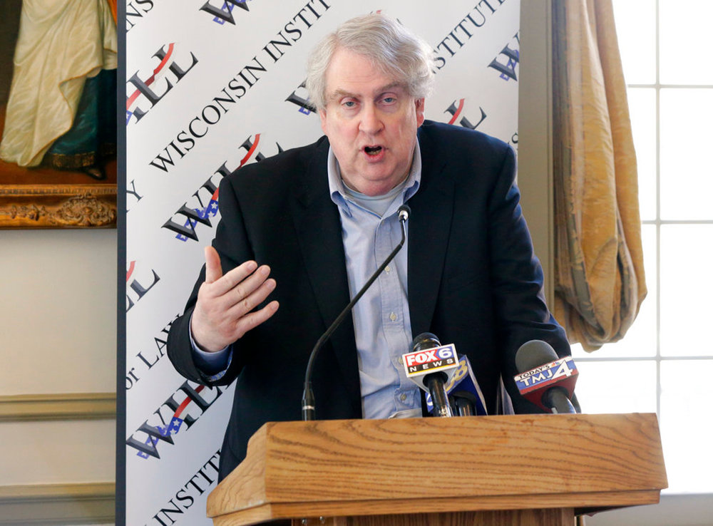 This photo take May 2, 2016, shows Marquette University Professor John McAdams, right, speaking during the news conference in Milwaukee. A dispute between the conservative professor and the university that fired him goes before the Wisconsin Supreme Court to decide whether the teacher's termination was because of a blog post or his conduct. Former Marquette University professor McAdams says in a lawsuit he was fired for exercising his freedom of speech by criticizing what he saw as an instructor shutting down a discussion against gay marriage. (Mike De Sisti/Milwaukee Journal-Sentinel via AP)